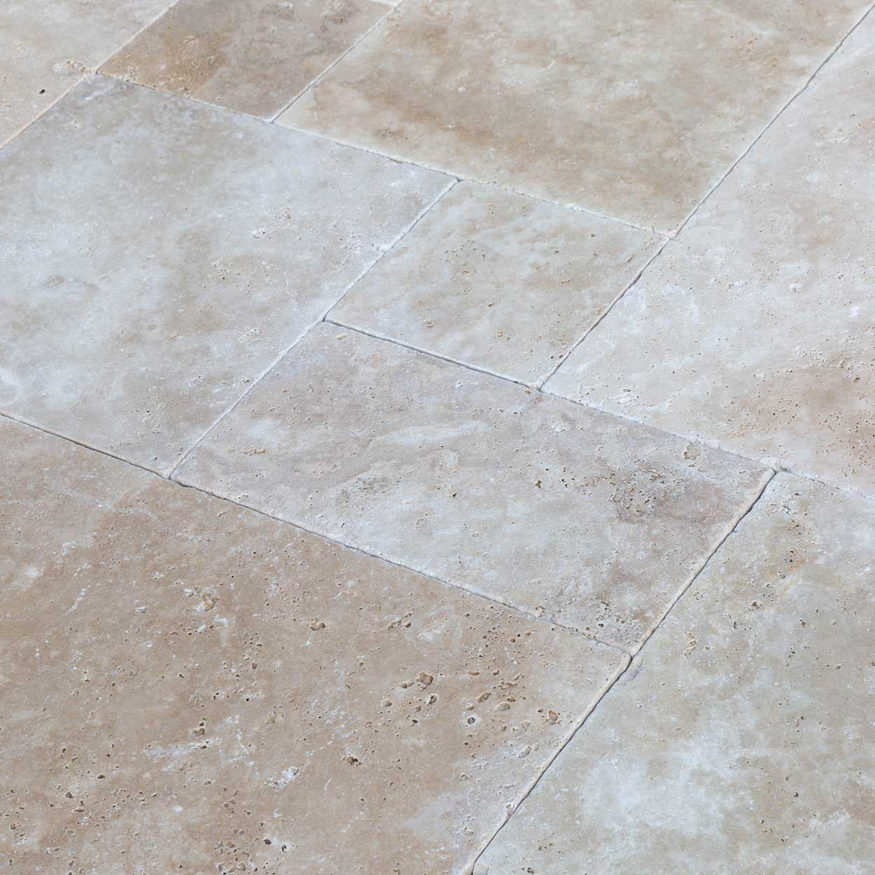 20012421-classic-light-antique-pattern-travertine-tiles-tumbled-chiseled-close-angle-www.thulahome.com